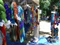 A vendors booth with roving and hand dyed yarns