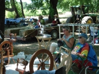Knitters relaxing under the trees